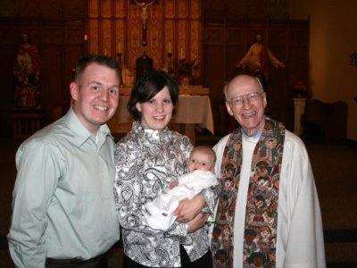 Photo of Mike, Katie and newborn Will Walter with Father Clay in 2008.